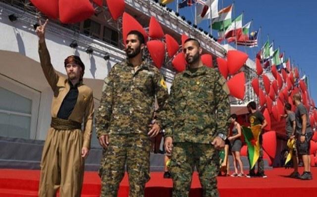 Photo of مقاتلو الـ YPG يسْتَعْرضون في مهرجان البندقية للأفلام بإيطاليا