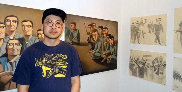 Photo of رسام صيني يقيم معرضاً في هامبورج لصور المقاتلين الكرد