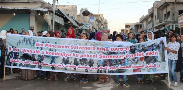 Photo of مسيرةٌ بمقاطعة كوباني في الذكرى الخامسة لمجزرة شنكال
